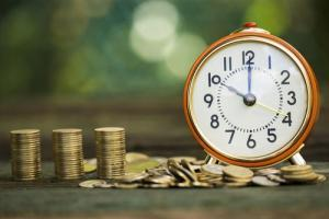 Alarm clock and money coin